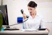 Angry woman shouting at phone — Stock Photo