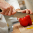 Mans hands cutting pepper. Salad preparation — Stockfoto #57934137