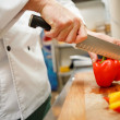 Closeup on hands cutting yellow pepper — Stock Photo #57934291