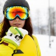 Beautiful young woman posing outdoors with her snowboarding gear — Stock Photo #62878099