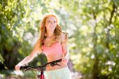 Woman on bicycle — Stock Photo