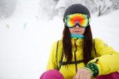 Portrait of pretty girlsitting on snow — Stock Photo