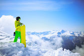 Snowboarder against sun and mountains — Stock Photo