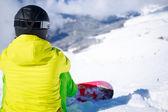 Snowboarder sitting — Foto Stock
