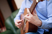 Man playing classic, acoustic guitar — Stock Photo
