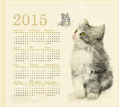 Calendar 2015 with fluffy kitten and butterfly — Stock Vector