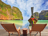 Two chaise lounges and beach table — Foto de Stock