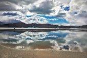 Lake Grey smooth cold water. — Stock Photo