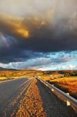 Low swirling cloud and  gravel road — Stock Photo