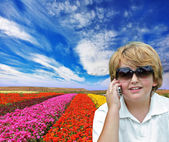 Boy with cell phone — Stock Photo