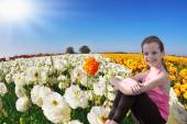 Girl with scythe and buttercups — Stock Photo