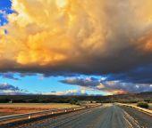 Cloud over gravel road — Stock Photo
