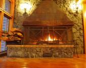 Huge burning fireplace — Stock Photo