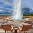 Geyser Strokkur in Iceland with  chairs and table — Stock Photo #57307313