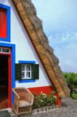 House with a triangular thatched roof — Stockfoto