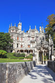 Medieval palace in the old park — Stock Photo