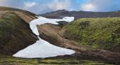 White spots snowfields in gullies — Stock Photo