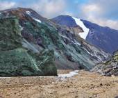 The green stone rock and stream — Stock Photo
