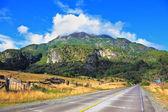 Wide highway runs between pastures — Stock Photo