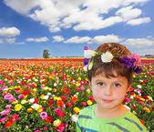The charming little boy in flower garland  — Stockfoto