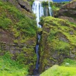 Scenic waterfall inside cave — Stock Photo #67808609