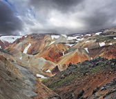 Multicolored mountains with snow — Stock Photo