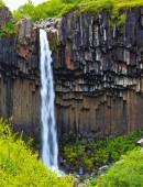Black stones in streams of water — Stock Photo