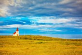 Chapel with red roof on fjord — Stock Photo