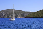 Two yachts in the bay of Aegean Sea. — Stock Photo