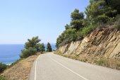 Mountain road on Aegean coast. — Stock Photo