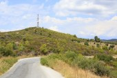 Road and television tower in the mountains. — Stock Photo