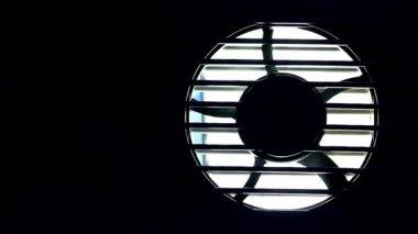 Industrial fan turbine behind a metal grate. — Stock Video