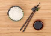Rice bowl and soy sauce — Stock Photo