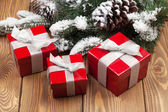 Christmas fir tree with red gift boxes — Stok fotoğraf