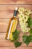 White wine bottle and grape — Stock Photo
