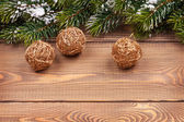 Christmas fir tree and baubles — Stock Photo