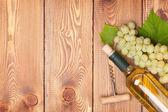 White wine bottle and rape — Stock Photo
