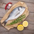 Fresh dorado fish cooking with spices and condiments — Stock Photo #54359939