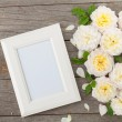 Blank photo frame and white roses — Stock Photo #54359943