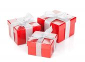 Three red gift boxes — Stock Photo