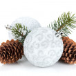 Silver christmas baubles and fir tree — Stock Photo #54791989