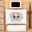 Постер, плакат: Sushi maki set with sakura branch