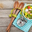 Постер, плакат: Fresh healthy salad and measuring tape