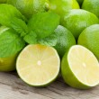 Fresh ripe limes with mint — Stock Photo #55358915