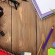 Office table with notepad, pencils, supplies — Stock Photo #55359157