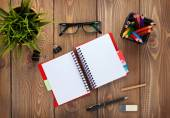 Office table with notepad, pencils, supplies — Stock Photo