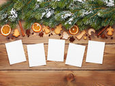 Christmas background with photo frames — Stock Photo