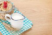 Breakfast with muesli, berries and milk — Stock Photo