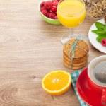 Healthy breakfast with muesli, berries, orange juice, coffee and — Stock Photo #55962415