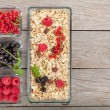 Healthy breakfast with muesli and berries — Stock Photo #55962499